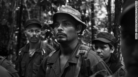 Colombia, November 2015 - Region of Meta, East of Colombia - A Guerrilla camp belonging to the Eastern Bloc of FARC-EP (Revolutionary Armed Forces of Colombia), the strongest military faction, in what could be their last days in the jungle - The morning call is issued at 4,30 am in the Farc Camps. After exercise session, rebels sing the organisation's hymn and the commander Aldinever reads the most important news of the day.    ----  The Colombian government is close to signing a historic peace agreement with the Revolutionary Armed Forces of Colombia (FARC) rebel group. After 51 years of often brutal conflict and three previous failed negotiations, FARC fighters seem finally ready to give up their guns.