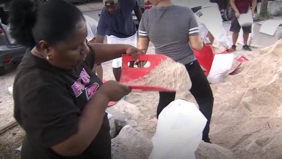 Daytona Beach residents fill sandbags Thursday.