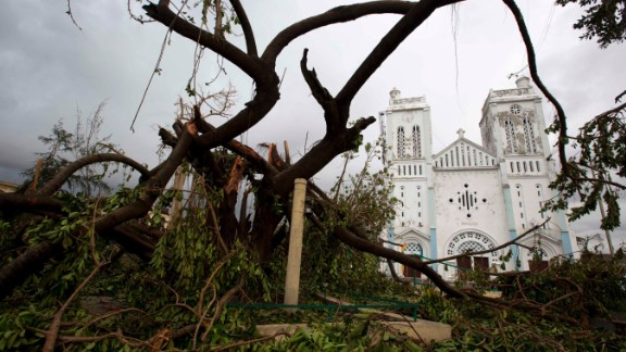 Fallen trees litter the ground outside a damaged church in Les Cayes on October 6. Hundreds of people have been killed in Haiti, the Dominican Republic and St. Vincent and the Grenadines, officials said, with the death toll expected to rise.