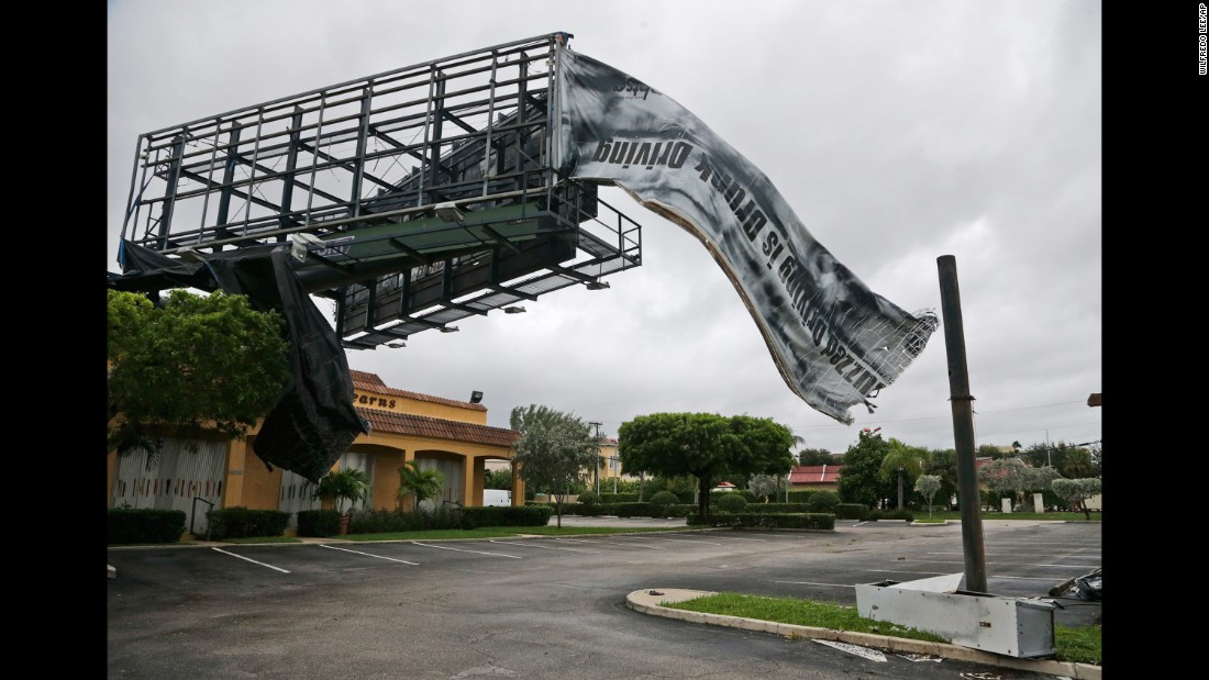 303236970a70 A billboard canvas flaps in the wind after Hurricane Matthew passed North  Palm Beach