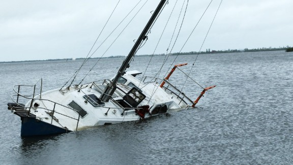 A damaged boat sits partially submerged on the intercoastal waterway in Melbourne, Florida, on October 7.