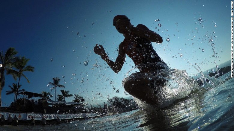 KAILUA KONA, HAWAII - OCTOBER 10:  An athlete exists the water after the 2.4-mile/3.8km swim during the IRONMAN World Championship presented by GoPro on October 10th 2015, Kailua Kona, Hawaii. (Photo by Hugh Gentry/IRONMAN) IRONMAN Triathlon consists of a 2.4-mile (3.86 km) swim, a 112-mile (180.25 km) bicycle ride and a marathon 26.2-mile (42.2 km) run. IRONMAN is considered one of the most difficult endurance events in the world.