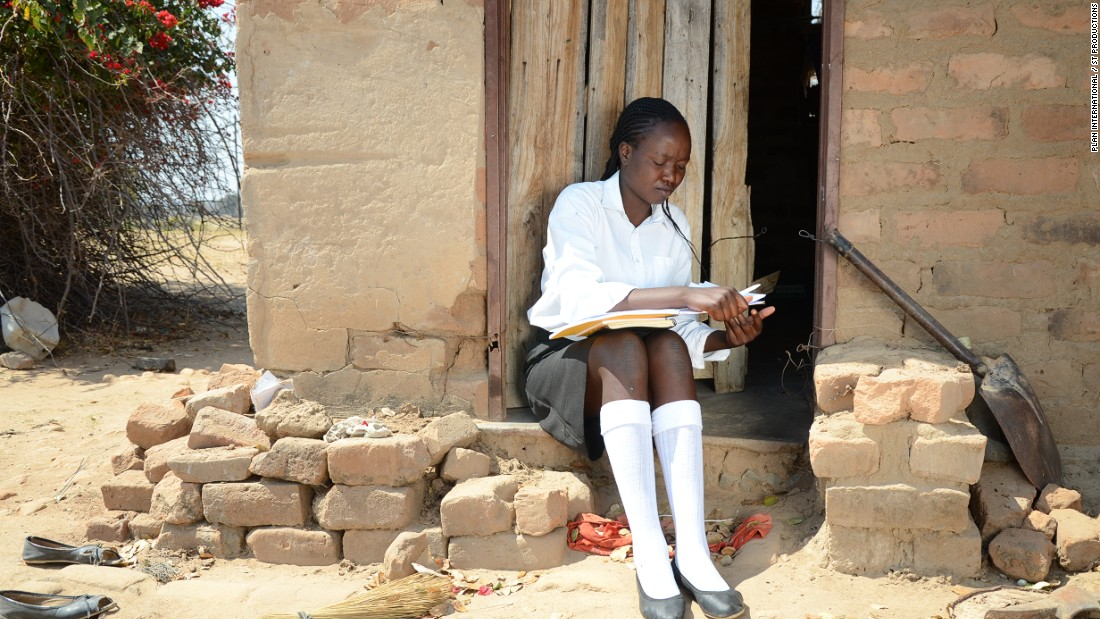 "Siphethangani, 18, pictured, finished secondary (high) school with flying colors and is now doing her A-Levels (college exams). ""I love school because that's the foundation of a good life,"" she tells the researchers. But life looks very different for some girls. From poverty to child marriage, there are an array of reasons why many young Zimbabwean women drop out of school. These are their stories, as told to Plan International. <br />"