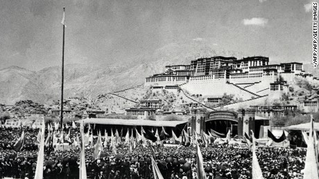The Tibetans gather in front of the Potala Palace, the former residence of the Dalai Lama in Lhasa, the capital of Tibet, on March 10, 1959, during an armed uprising against Chinese rule.