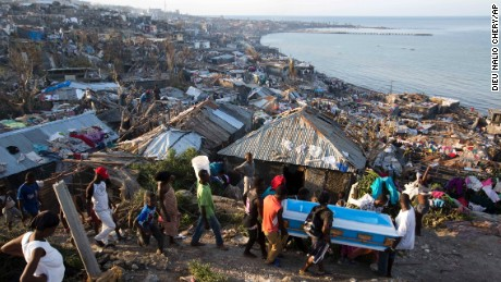 In Jeremie, Haiti, Hurricane Matthew claimed the life of a pregnant woman, whose remains were carried in a coffin by local residents on Friday, October 7, 2016.