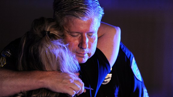 Palm Springs peace officers hug each other at Desert Regional Medical Center on Saturday night.