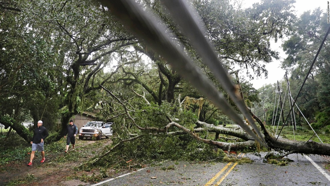 A downed tree and power lines block a road on Georgia's St. Simons Island on October 8.