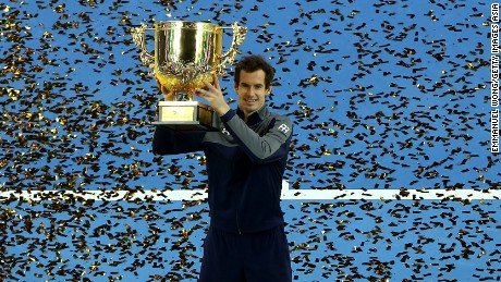 Andy Murray of Great Britain poses with his trophy after winning the China Open for the first time.