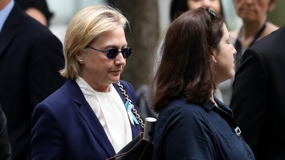 Clinton arrives at a 9/11 commemoration ceremony in New York on September 11. Clinton, who was diagnosed with pneumonia two days before, left early after feeling ill. A video appeared to show her stumble as Secret Service agents helped her into a van.