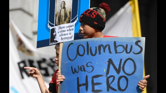 Young demonstrators protest a Columbus Day parade in Denver on Saturday.