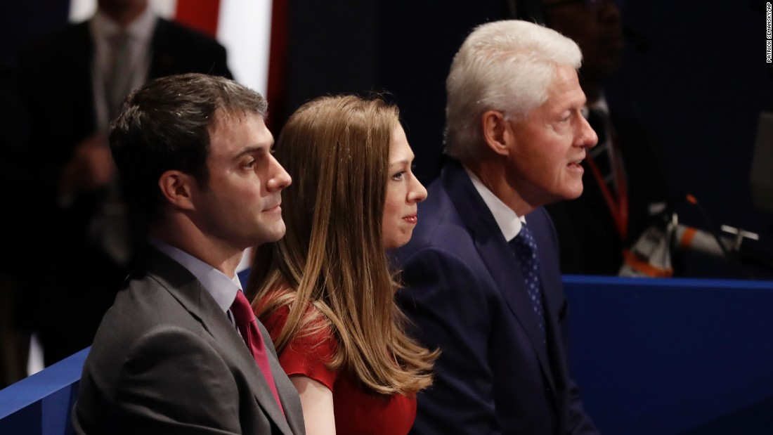 Bill Clinton, right, sits with his daughter, Chelsea, and Chelsea's husband, Marc Mezvinsky.