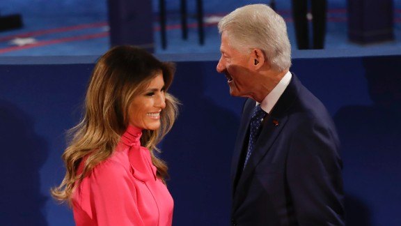 Melania Trump passes Bill Clinton after their handshake.