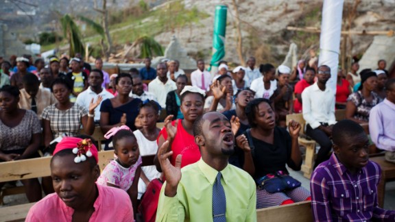Worshippers pray at a Jeremie church destroyed by Matthew on October 9.