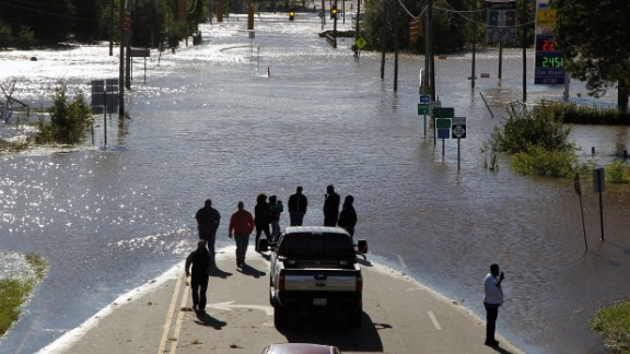 People stop and take pictures of Highway 58, which was flooded in Nashville, North Carolina, on October 9.