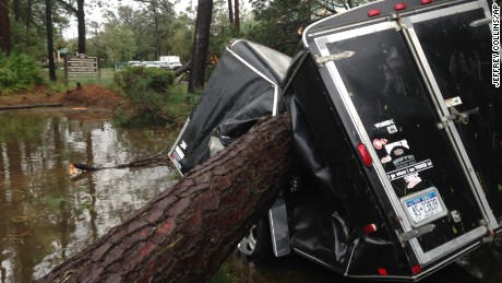 A trailer is crushed by a downed tree in Hilton Head, South Carolina.