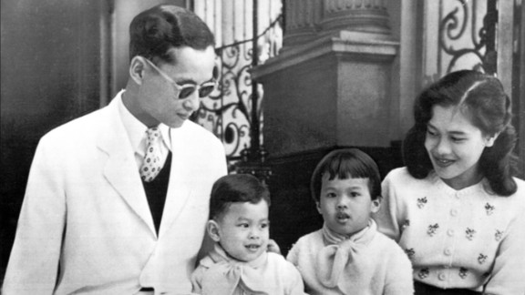 The King and Queen pose with their children, Crown Prince Vajiralongkorn and Princess Ubol Ratana, on the steps of Bangkok