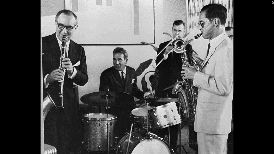 The King, far right, plays the saxophone during a 1960 jam session with legendary jazz clarinetist Benny Goodman and his band in New York.