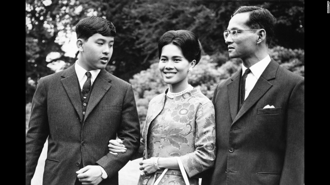 The King walks with his wife and their 13-year-old son, Crown Prince Vajiralongkorn, during a visit to Britain in 1966.