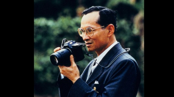 The King raises a camera to take a photo in 1995. He was given his first camera in 1934, which ignited a lifelong enthusiasm for photography. He has often been seen with a camera around his neck during public appearances.