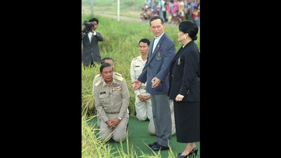 The King and Queen survey a rice crop made possible by a Royal Irrigation Project in 1996. The project formed part of the Royal Development Projects, which focused on developing remote rural areas. The King has taken an interest in environmental projects throughout his long reign.