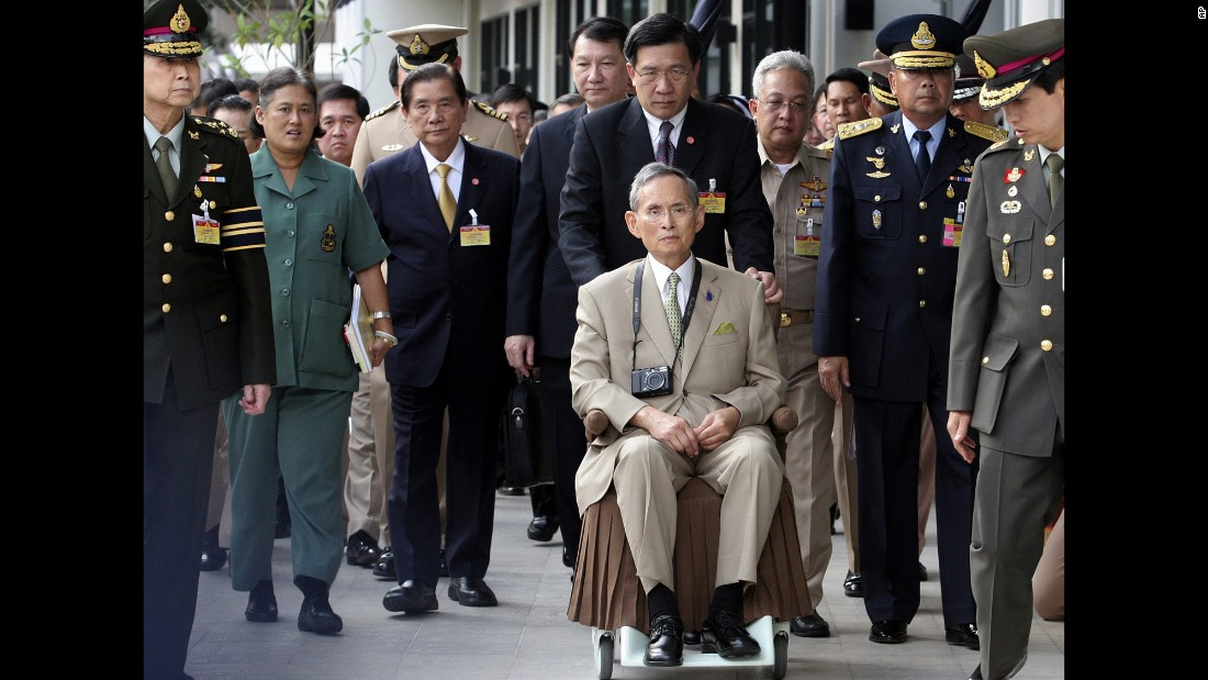 The King is wheeled towards his yacht in 2010, during a rare public appearance to open a new flood gate and two bridges in Bangkok.