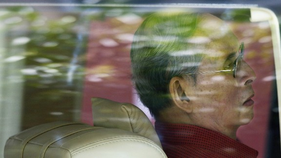 The King is seen through a car window as he leaves the Siriraj hospital in Bangkok in 2015.