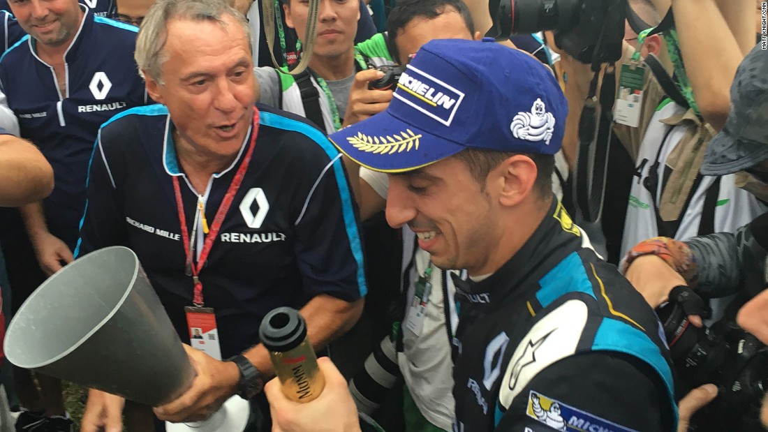 Race winner Sebastien Buemi savors victory after taking the checkered flag at the first Hong Kong ePrix.