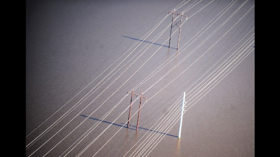 Floodwaters surround power lines near Nichols on October 10.
