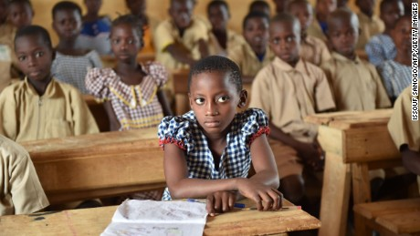 "This photo taken on March 7, 2016 shows pupils in a classroom of the first elementary school built in 2013 by Swiss group Nestle, in the village of Goboue, in the southwest of Ivory Coast.  ""At five years old, I went to work in the fields with my dad. Today, my children go to school,"" said Peter, a cocoa farmer in Bonikro in the centre of Ivory Coast. Peter is one of a generation of farmers at the heart of a drive to keep the country's children in school and away from its vast plantations. / AFP / ISSOUF SANOGO        (Photo credit should read ISSOUF SANOGO/AFP/Getty Images)"