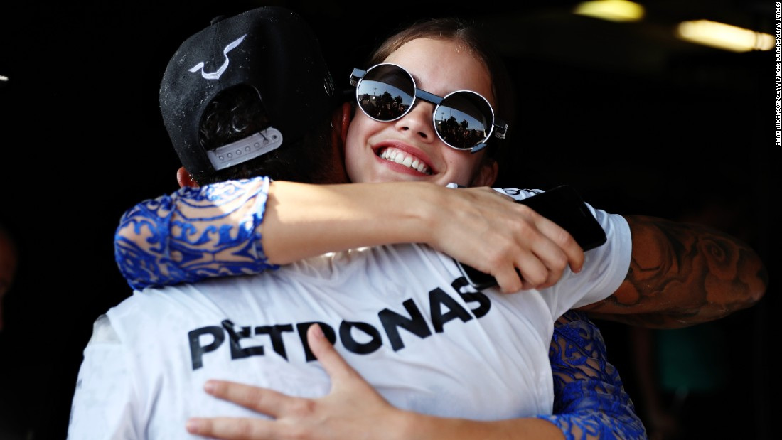 "Hamilton earns a hug from Hungarian model Barbara Palvin as he takes the lead in the world championship for the first time in 2016 <a href=""http://cnn.com/2016/07/24/motorsport/hungarian-grand-prix-lewis-hamilton/"" target=""_blank"">thanks to a win in Budapest. </a>The British driver moved into a six-point lead over Rosberg, who finished second."