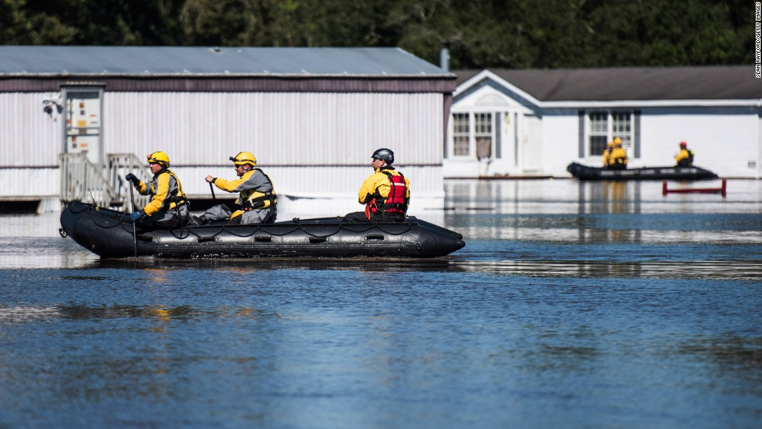 Rescue teams maneuver through floodwaters in Lumberton, North Carolina, on October 10. President Barack Obama has declared a major disaster in North Carolina and ordered federal aid to supplement state, tribal and local recovery efforts.