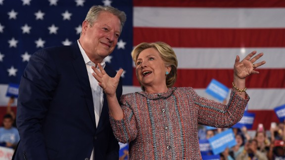 Former Vice President Al Gore (L) speaks with Democratic presidential nominee Hillary Clinton during a climate change event at Miami Dade College-Kendall Campus in Miami, Florida October 11, 2016.