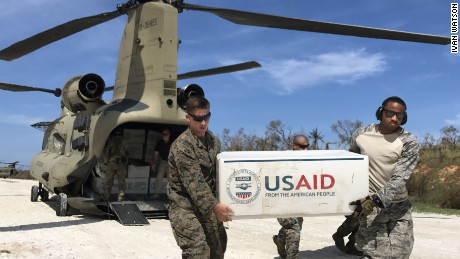 US troops unload plastic tarps with aid outside the town of Jeremie in the aftermath of Hurricane Matthew in 2016.