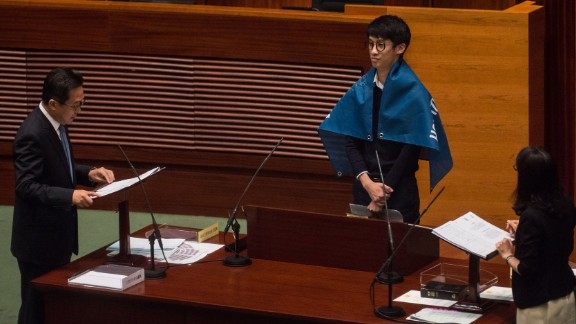 """Lawmakers not only displayed flags declaring that Hong Kong is not a part of China but also called out for """"democratic self-determination"""" for the semi-autonomous Chinese city at Wednesday's oath taking session."""