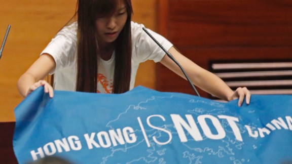 """Youngspiration's Yau Wai-ching told the city's Legislative Council: """"I do solemnly swear that I will be faithful and bear true allegiance to the Hong Kong nation,"""" after laying out a flag bearing the words """"Hong Kong is not China."""""""