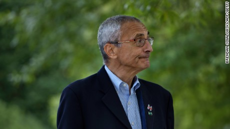 John Podesta walks to Democratic presidential nominee Hillary Clinton's Washington, DC, home October 5, 2016.
