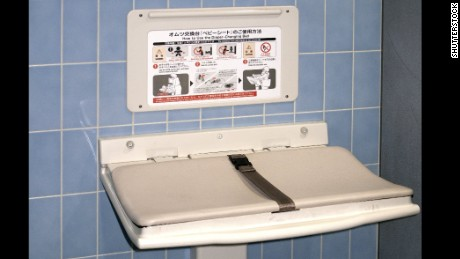 Dad-in-chief signs law bringing diaper-changing stations to more men's rooms