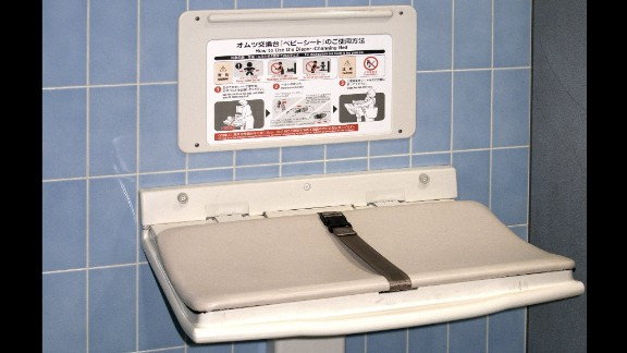 Diaper changing table in a public men's restroom.