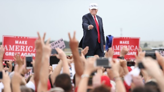 Republican presidential nominee Donald Trump acknowledges supporters at the conclusion of his campaign rally on the tarmac of Lakeland Linder Regional Airport in Lakeland, Florida on October 12, 2016. / AFP / Gregg Newton        (Photo credit should read GREGG NEWTON/AFP/Getty Images)