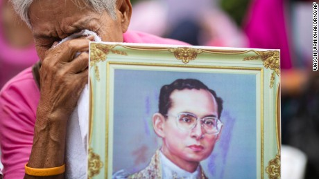 A woman prays for Thailand's King Bhumibol Adulyadej at Siriraj Hospital where the king was being treated in Bangkok, Thailand.