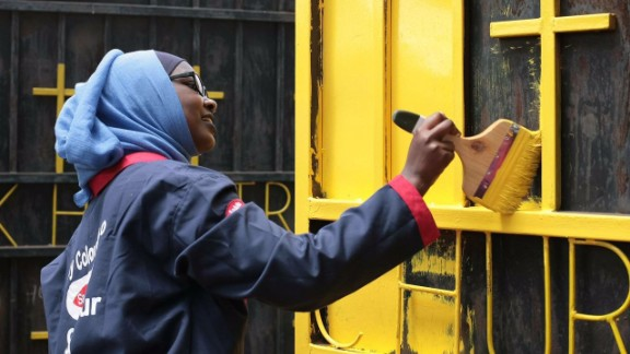 The yellow lick of paint serves as a striking symbol of unity and peace between Muslims and Christians.
