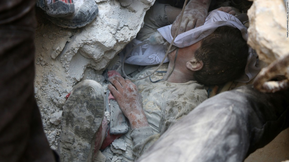 "Jameel Mustafa Habboush, a 13-year-old boy, receives oxygen as he is pulled alive from the rubble of a building in Aleppo, Syria, after airstrikes on Tuesday, October 11. <a href=""http://www.cnn.com/2016/10/13/middleeast/syria-aleppo-airstrikes/index.html"" target=""_blank"">Violence continues to rage</a> throughout various rebel-held neighborhoods in Aleppo."