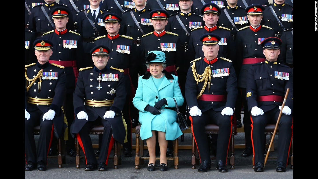 Queen Elizabeth II poses for a group photograph with the British Army's Corps of Royal Engineers in Chatham, England, on Thursday, October 13. It was the Corps' 300th anniversary.