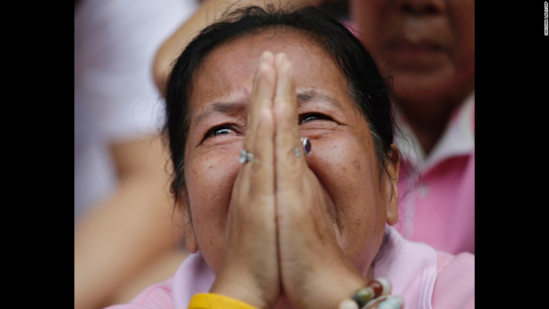 "A woman mourns for King Bhumibol Adulyadej outside the Siriraj Hospital where he was being treated in Bangkok, Thailand, on Thursday, October 13. Bhumibol, <a href=""http://www.cnn.com/2016/10/13/asia/thai-king-bhumibol-adulyadej-obituary/index.html"" target=""_blank"">who died at  age 88</a>, was the world's longest reigning monarch and a deeply respected leader who worked to unify his country's people. <a href=""http://www.cnn.com/2016/10/12/asia/gallery/thai-king-bhumibol-adulyadej/index.html"" target=""_blank"">Thailand's King Bhumibol Adulyadej: A life in pictures</a>"