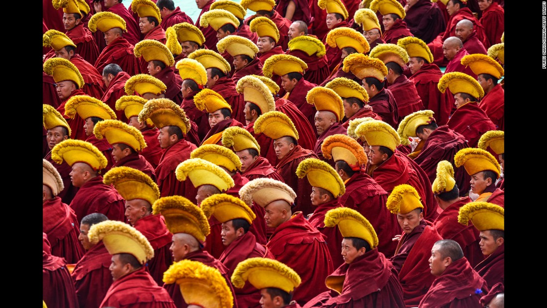 Monks attend a ceremony marking the 600th anniversary of the founding of the Drepung Monastery in Lhasa, China, on Wednesday, October 12.