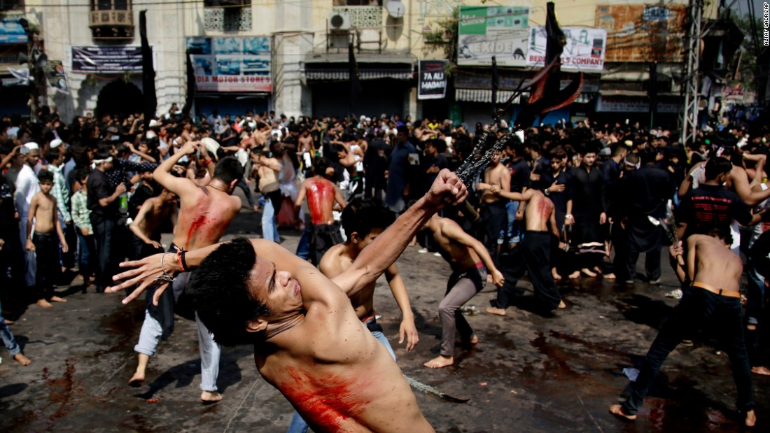 Muslims flagellate themselves with knives during an Ashura procession in New Delhi on Wednesday, October 12. Ashura is a holiday that commemorates the death of Imam Hussein, a grandson of Prophet Mohammed.