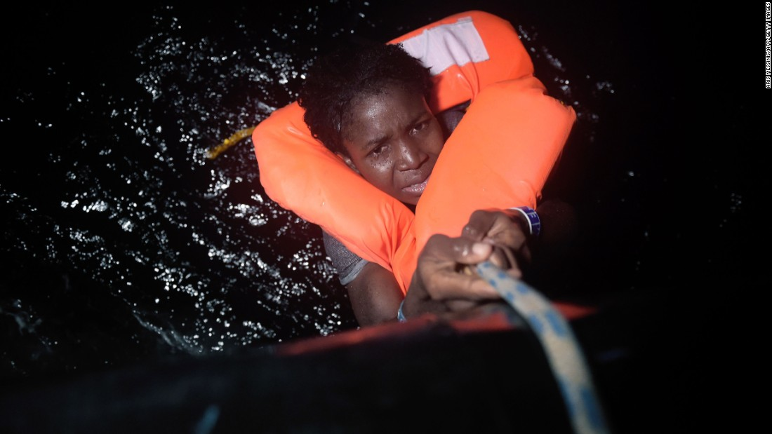 "A woman holds onto a rope during a migrant rescue operation near Libya's Mediterranean coast on Wednesday, October 12. Thousands of migrants have been making the dangerous journey across the Mediterranean, with many fleeing war-torn countries in Africa and the Middle East. <a href=""http://www.cnn.com/2015/09/03/world/gallery/europes-refugee-crisis/index.html"" target=""_blank"">Europe's migration crisis in 25 photos</a>"