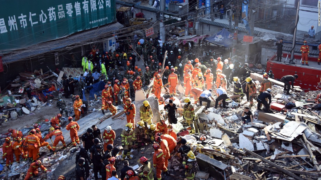 "Rescuers search for survivors after four residential buildings caved in early on the morning on Monday, October 10, in Wenzhou, China. <a href=""http://www.cnn.com/2016/10/10/asia/china-building-collapse/"" target=""_blank"">At least 22 people were killed</a> and it is unclear what caused the buildings to collapse."