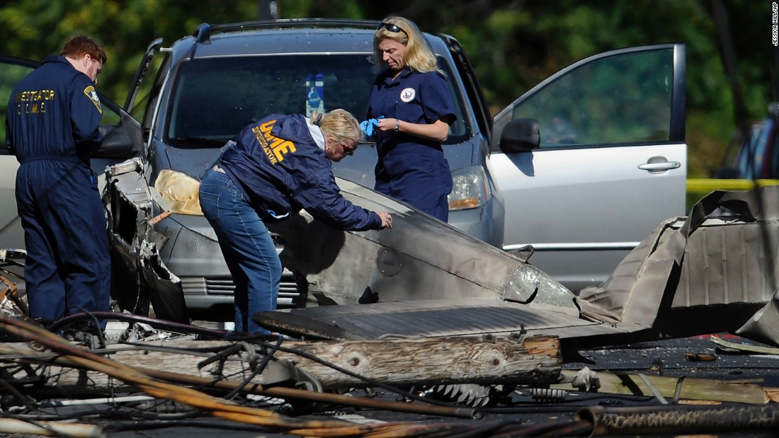 "Investigators look at the remnants of a small plane in East Hartford, Connecticut, on Wednesday, October 12. The plane crashed a day before, killing a student pilot who investigators suspect <a href=""http://www.cnn.com/2016/10/12/us/connecticut-plane-crash-possibly-intentional/"" target=""_blank"">committed the act intentionally</a>."