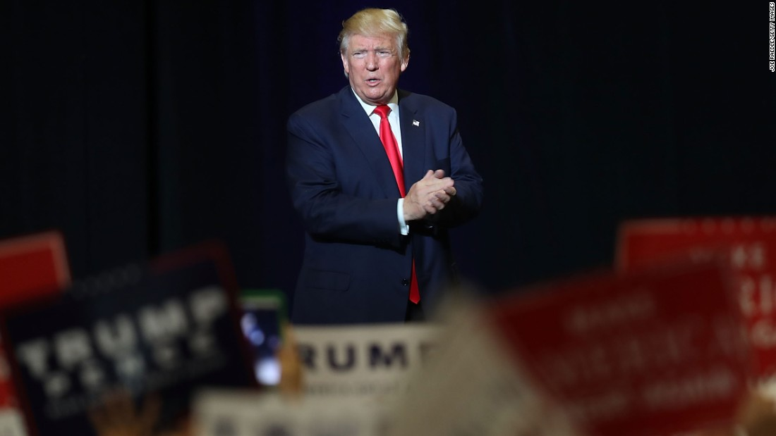 Former Trump campaign staffer sues, alleging that Trump kissed her without consent